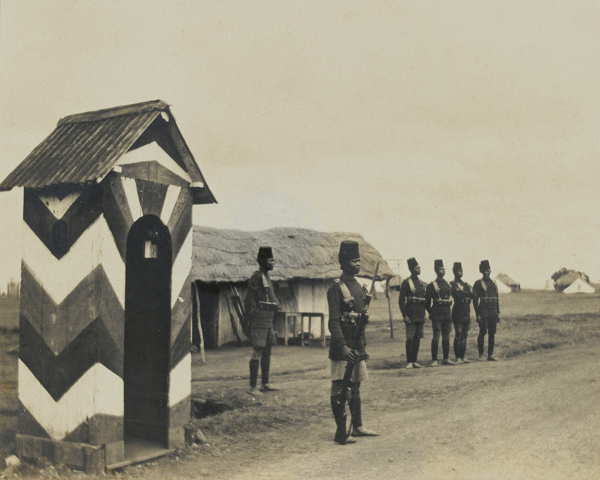 A King's African Rifleman by a sentry box, 1916