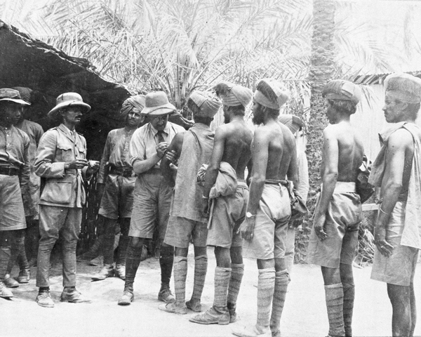 Indian troops line up to receive inoculations, 1916