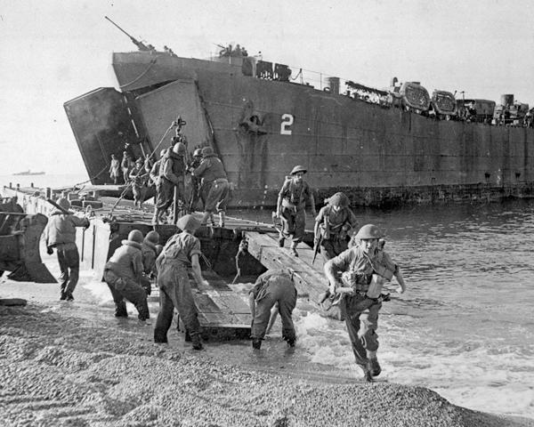 Disembarkation of men and equipment from a landing ship at Salerno, 1943