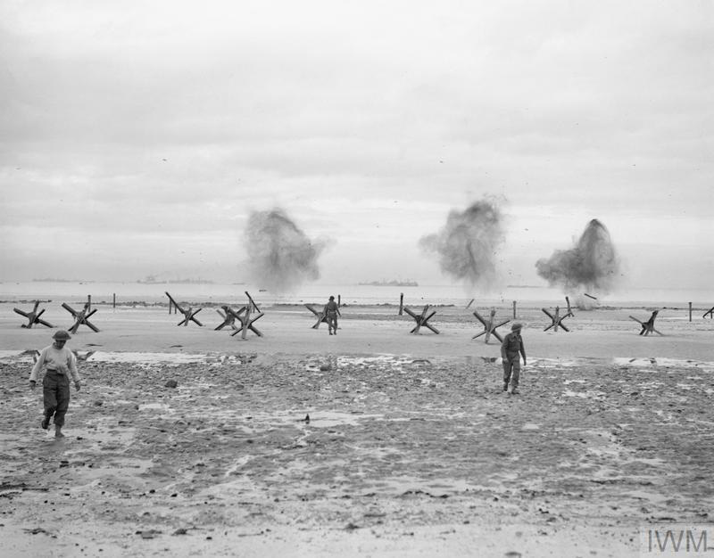 Royal Navy personnel blowing up beach obstacles, Normandy, 1944