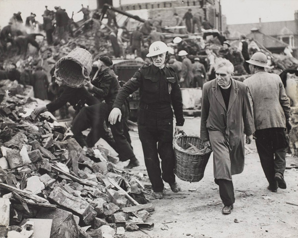 A clergyman and Civil Defence workers helping to clear the debris of a school during the London Blitz, 1940