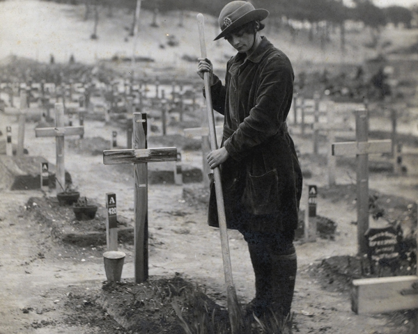 A member of the Women's Army Auxiliary Corps tends a graveyard at Etaples, 1918
