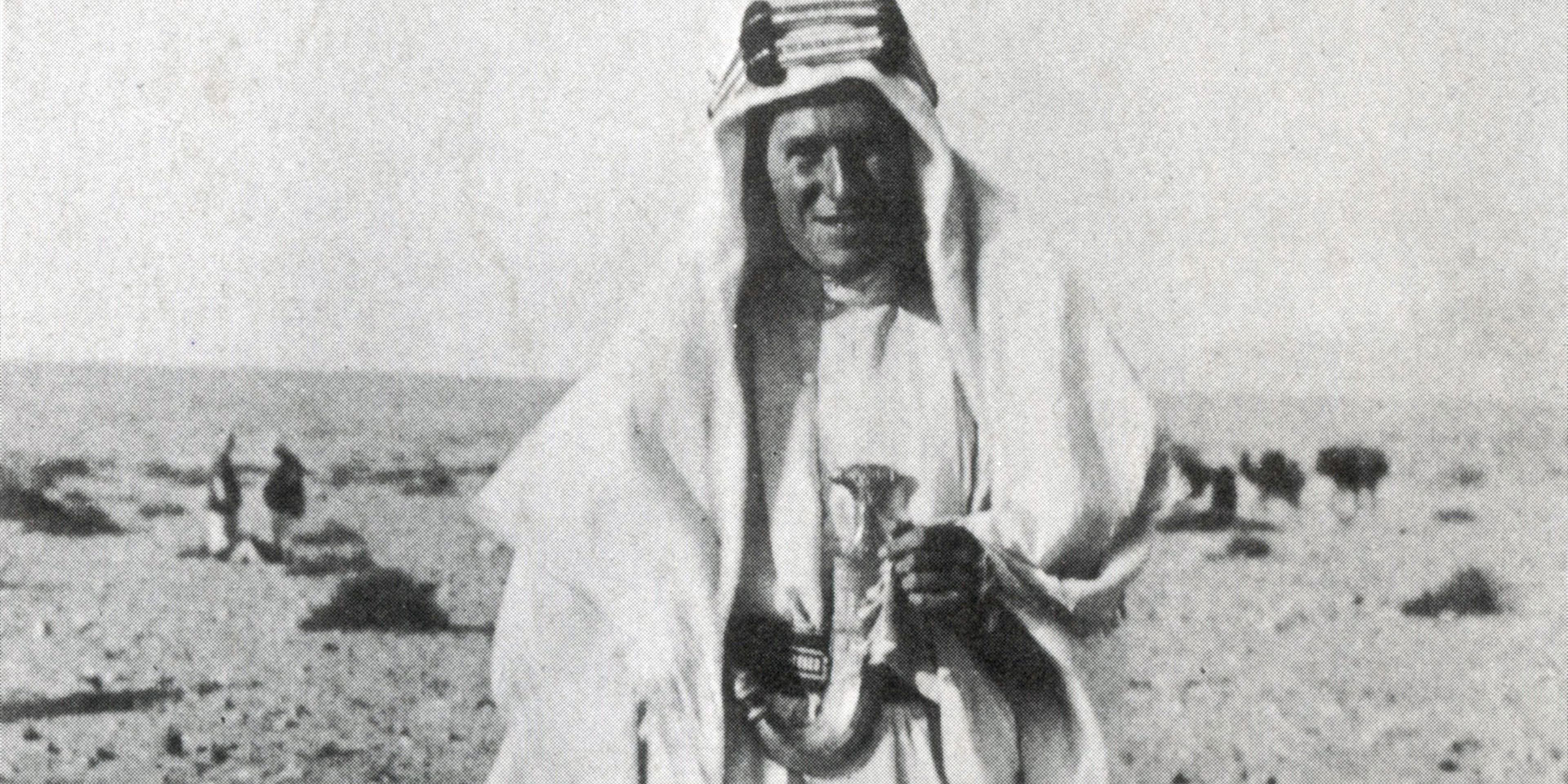 TE Lawrence in the desert in traditional Arab garb, c1917
