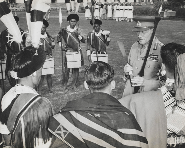 Field Marshal Sir Claude Auchinleck with Naga troops in their traditional ceremonial dress, 1946