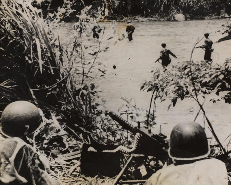 American infantry cross a jungle stream covered by a machine gun, New Guinea, c1943