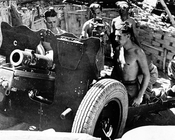 Firing a 3.7 in howitzer during the Battle of the Ngakyedauk Pass, February 1944