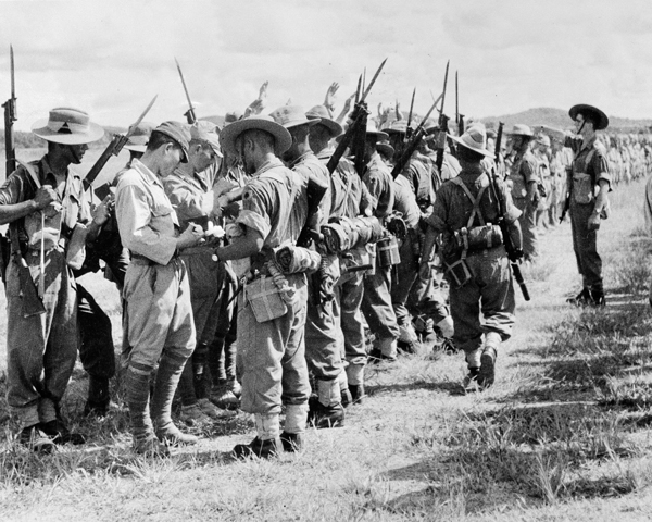 Searching Japanese troops after their surrender in Kuala Lumpur, Malaya, 1945