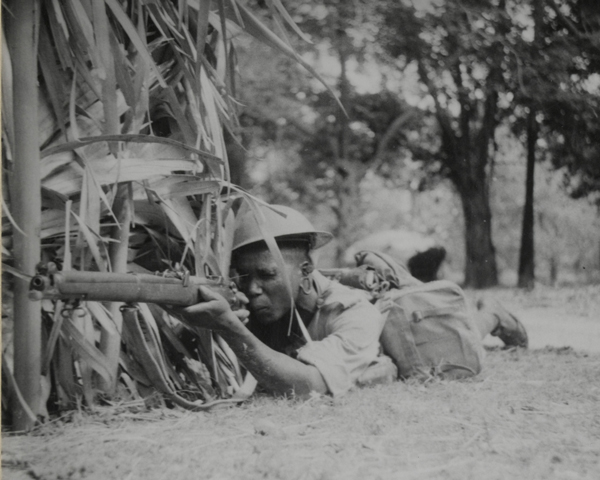 A King's African Rifleman covering a road, 1943
