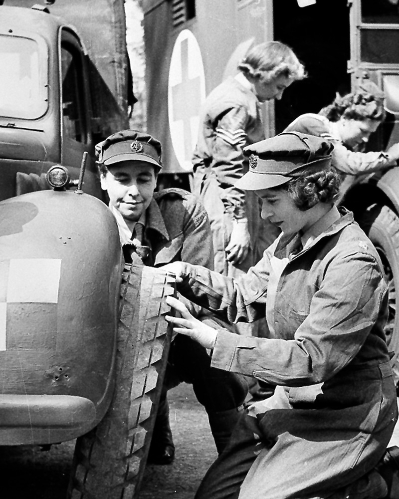 Princess Elizabeth changing the wheel of a vehicle, 1945