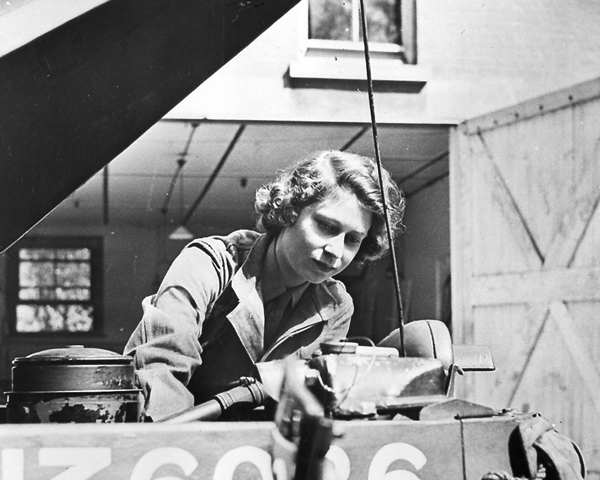 Princess Elizabeth working on a car engine, 1945