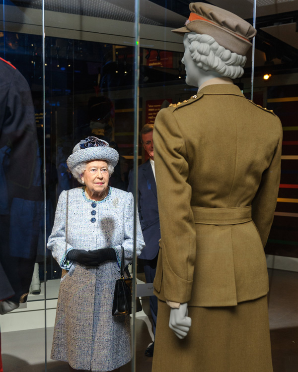 Queen Elizabeth II views her old WRAC uniform at the National Army Museum, 2017