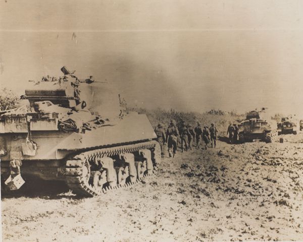Infantry and tanks moving up in Italy, October 1943