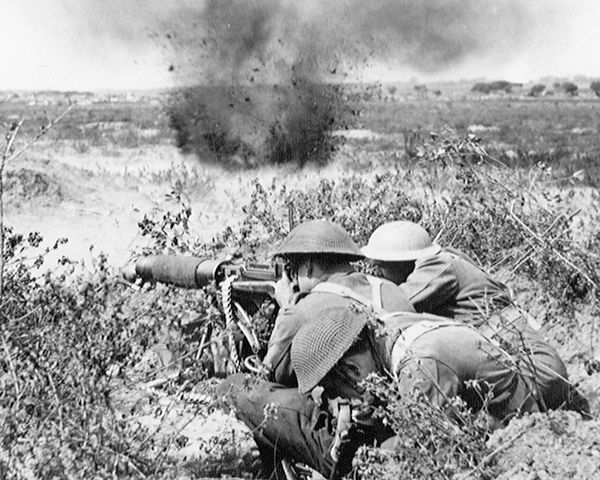 Soldiers of the Middlesex Regiment open fire with a Vickers Machine Gun, 1944
