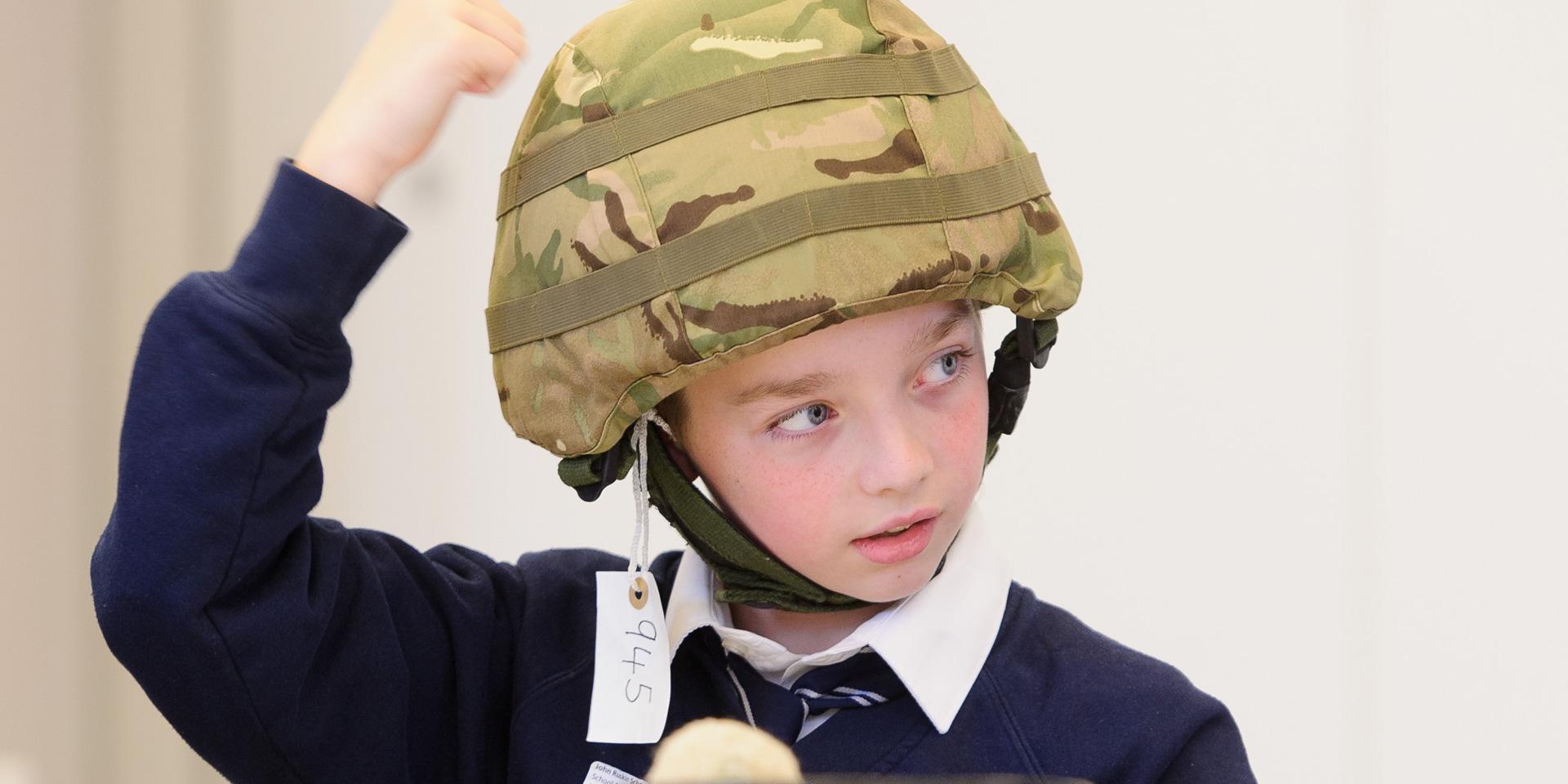 School boy trying on a helmet