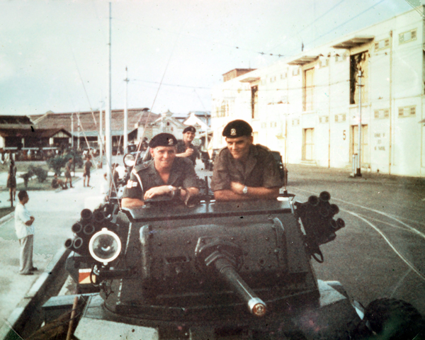 Members of 15th/19th Kings Royal Hussars aboard their Daimler armoured car, Malaya, 1957