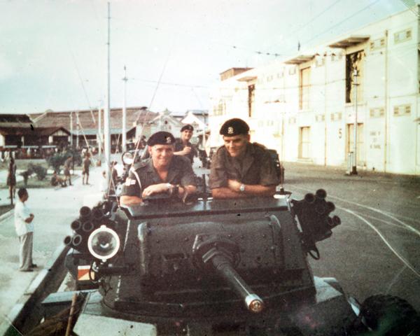 Members of 15th/19th Kings Royal Hussars aboard their Daimler armoured car, Malaya, 1957