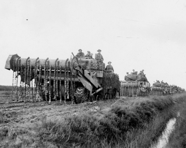 Men of the 2nd Argyll and Sutherland Highlanders hitch a ride on a flail tank, 1944