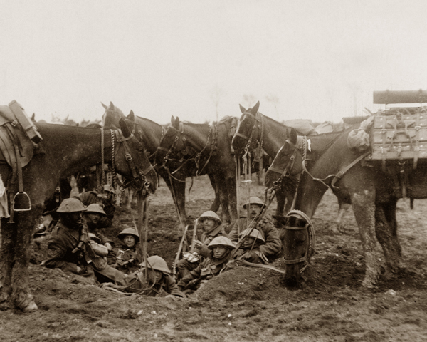 Cavalrymen resting in a shell hole during the Battle of the Scarpe, April 1917