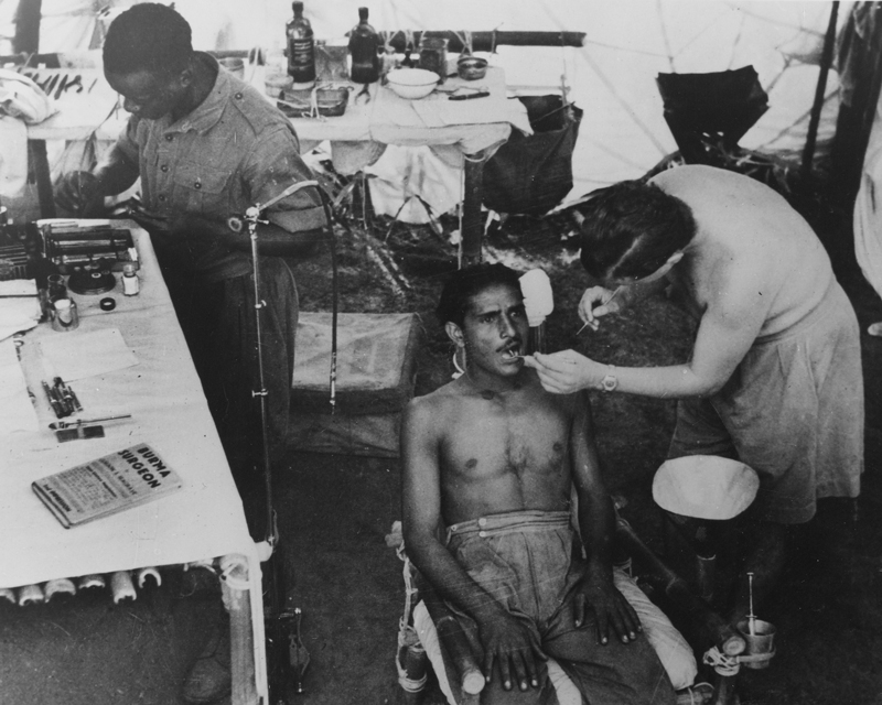 A dentist treats an Indian Army patient in Burma, c1944