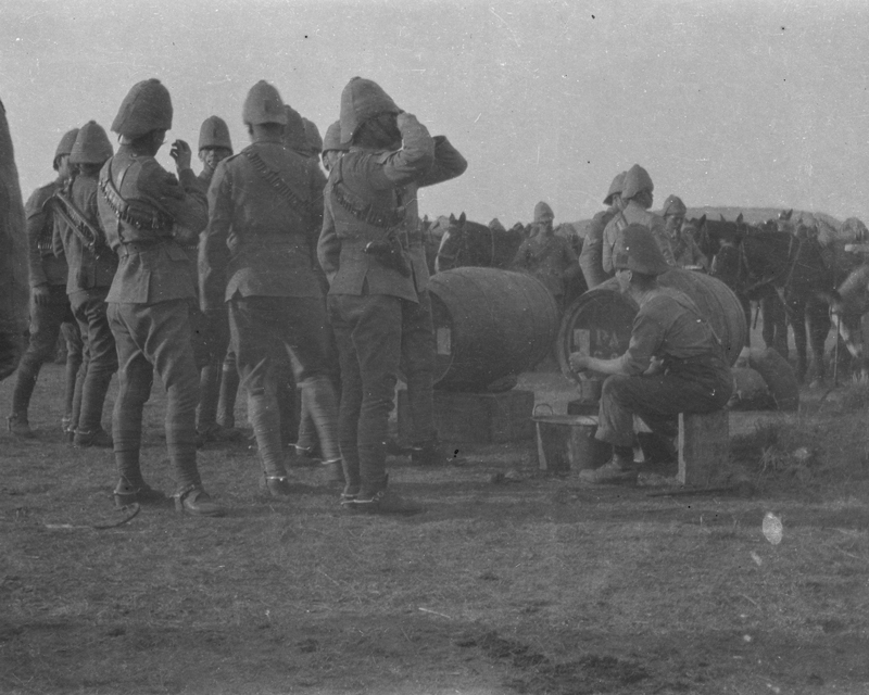Members of the 18th Hussars enjoy a beer at Zand Spruit, South Africa, 1900
