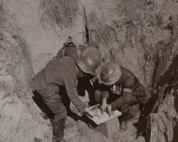 Officers interrogating a German prisoner captured during a raid, c1917