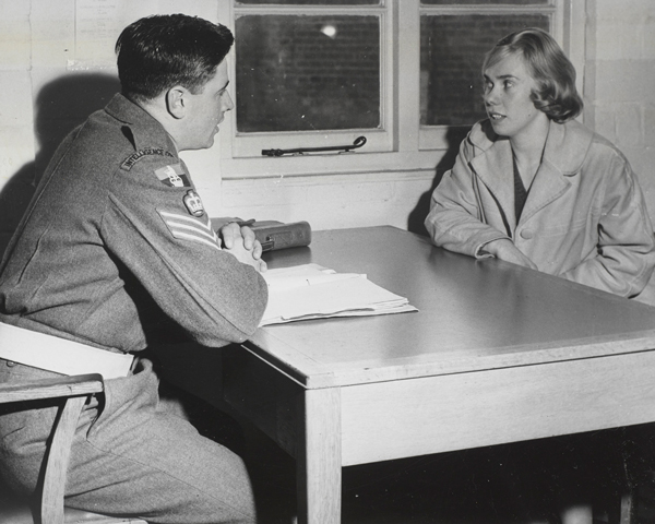An Intelligence Corps warrant officer questioning a civilian, c1960