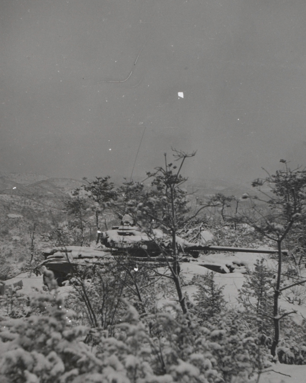 A Centurion tank of the 5th Royal Inniskilling Dragoon Guards dug in on Hill 159, 1951