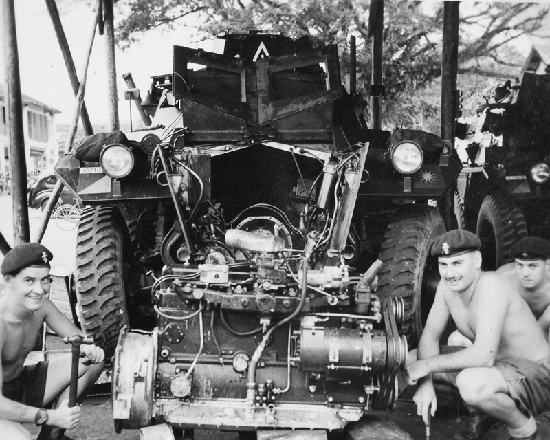 REME craftsmen repairing the engine of a Saracen armoured car, Malaya, 1957