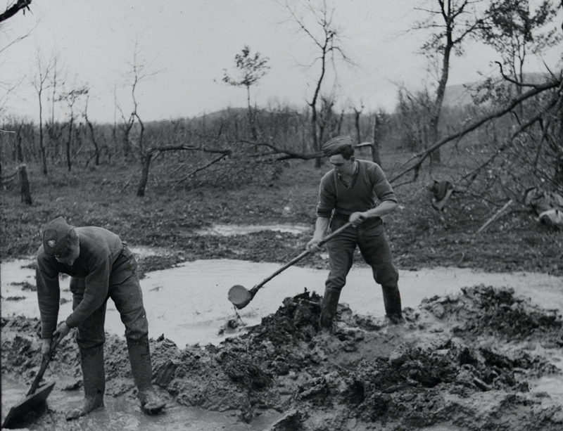 Clearing mud from the forward positions of the 1st East Surrey Regiment on the Rapido River, Italy, 1944