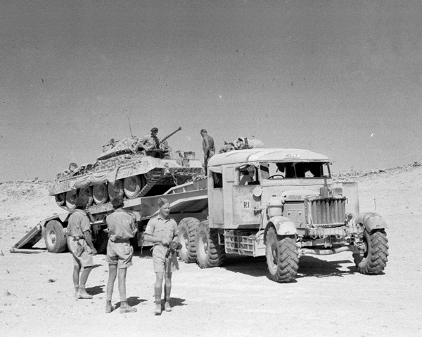Loading a Crusader tank on to a Scammell transporter, North Africa, 1943