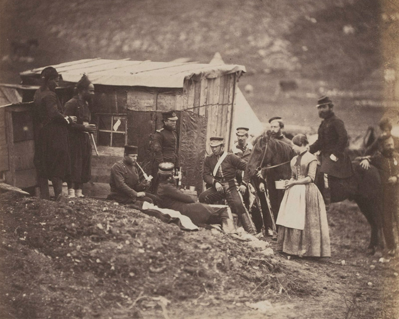 Mrs Rodgers (standing on the right) with soldiers of the 4th Dragoon Guards in the Crimea, 1855.