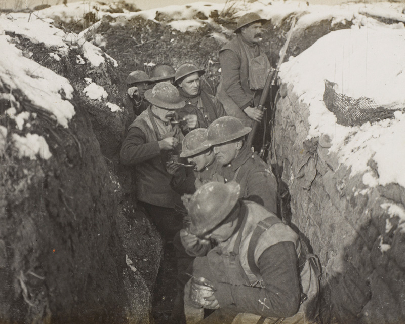 Soldiers from the 6th (Service) Battalion, The Queen's (Royal West Surrey Regiment), enjoy a hot meal in the trenches near Arras, 1917
