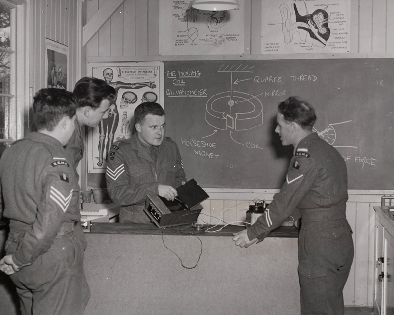 A RAEC sergeant instructs men from the Royal Electrical and Mechanical Engineers, c1955