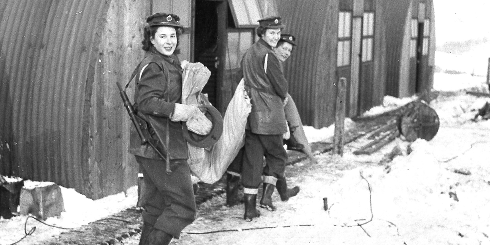 ATS women outside their Nissen huts, 1945