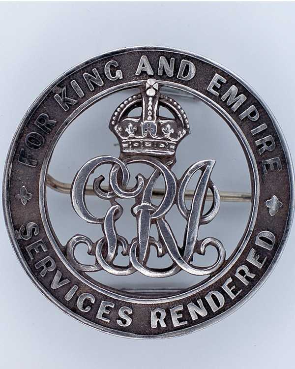 Discharge badge awarded to Private E Gibbs, 9th East Surrey Regiment, 1918