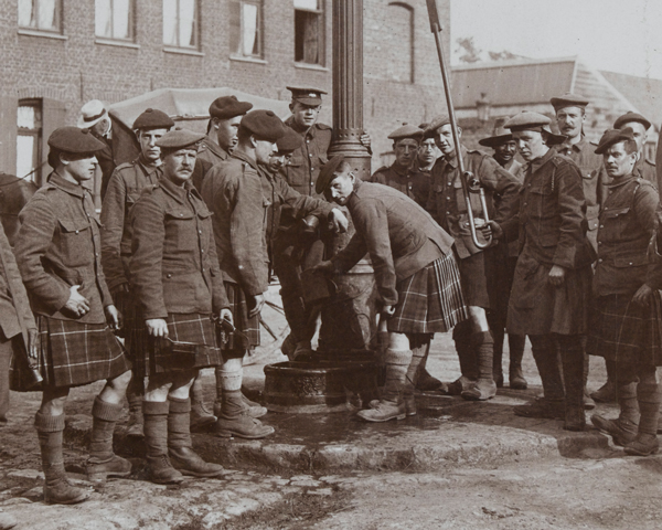 Seaforth Highlanders filling their water-bottles at a town pump, 1915