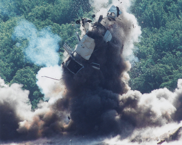 Destruction by RLC ordnance disposal of a car used to transport weapons and explosives, Kosovo, 1999