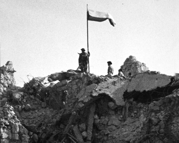 Poles of the 3rd Carpathian Division raising their flag over Monte Cassino, May 1944