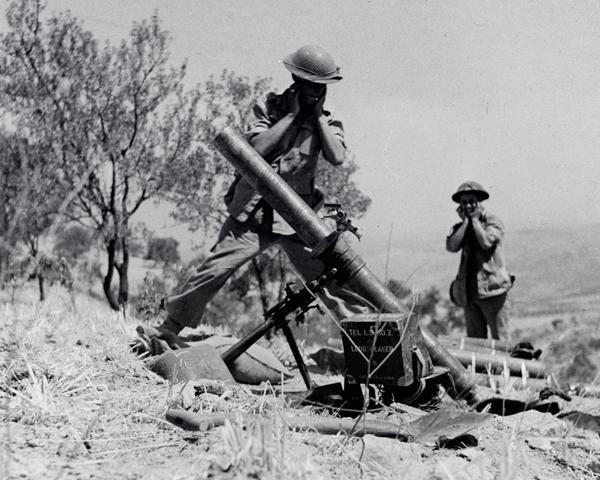 Using a 4.2 inch mortar near Adrano, Sicily, 1943
