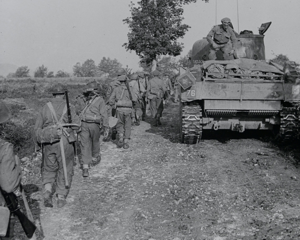 Infantry and tanks moving along a track towards the Hitler Line, Italy, May 1944