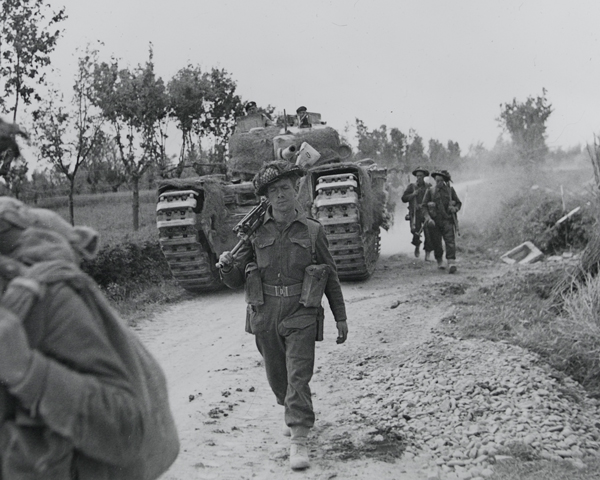 Infantry and a supporting Churchill tank advancing along the Argenta road, April 1945