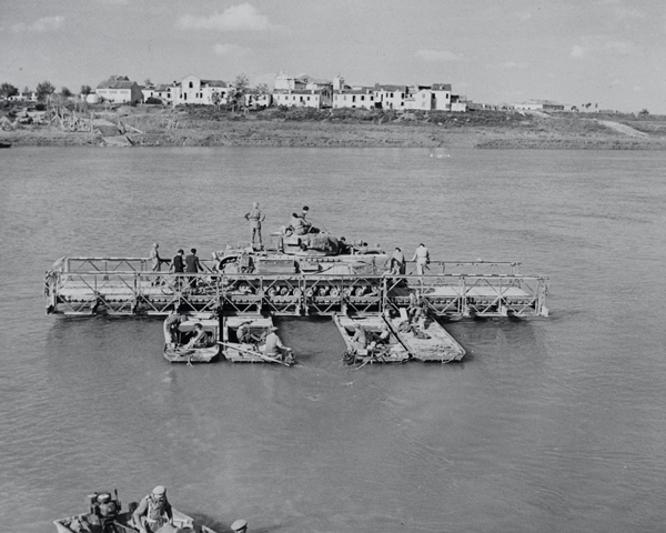 A Churchill tank crossing the River Po on a pontoon ferry, April 1945