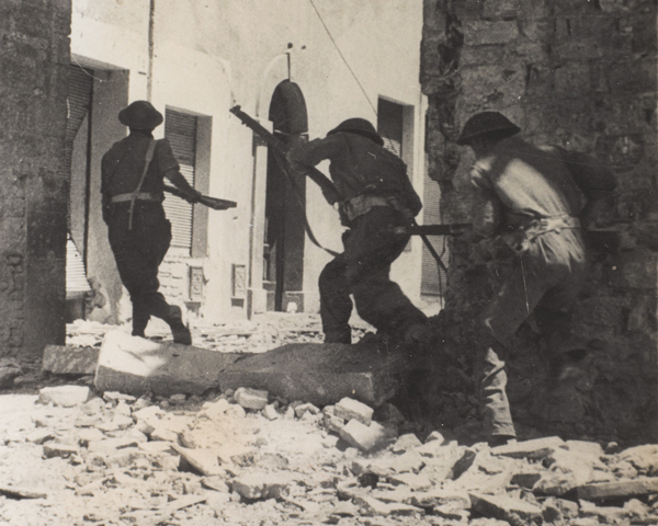 Infantry moving through the streets of Castiglione, November 1944