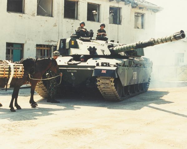 A King's Royal Hussars Challenger tank alongside pack horses, Bosnia, 1997