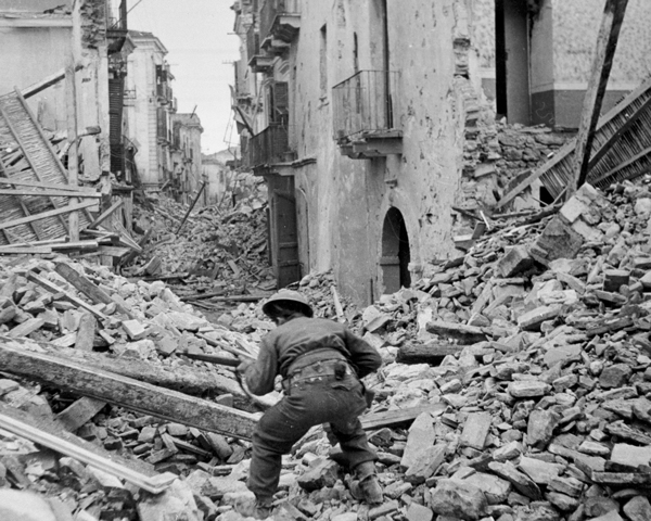 A Canadian infantryman searching the ruins of Ortona for snipers, 1943