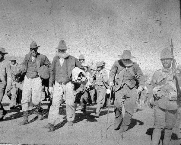 Boer prisoners escorted by a Durham Light Infantryman, c1901