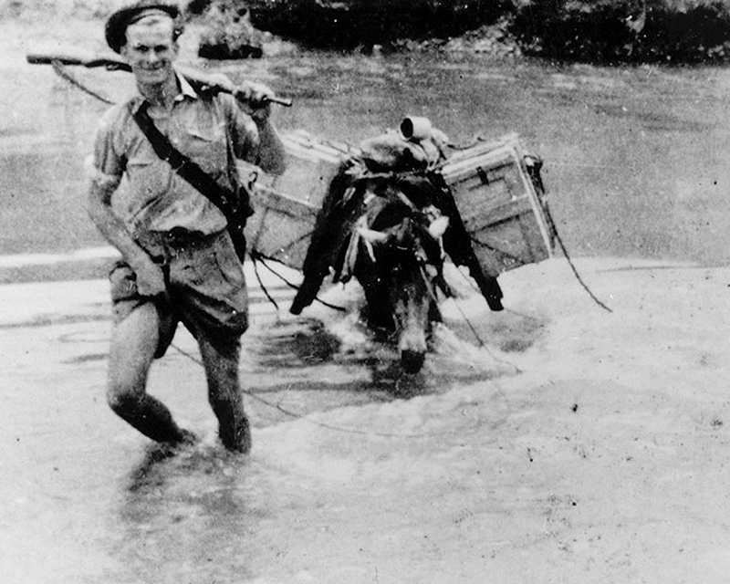 A member of the 2nd King's Own Yorkshire Light Infantry crossing a river, Burma, c1942