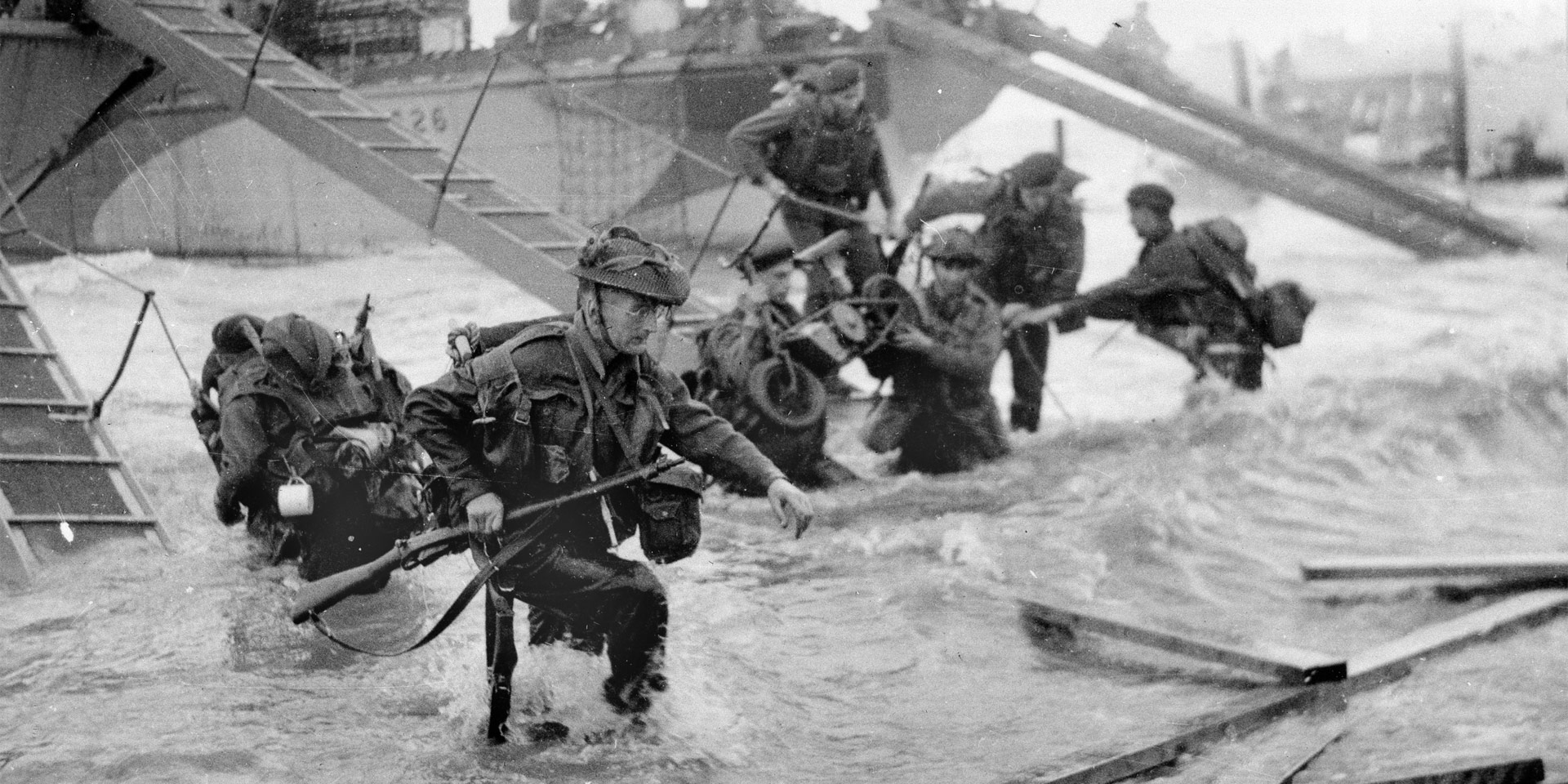 Troops wading ashore from landing craft, 6 June 1944