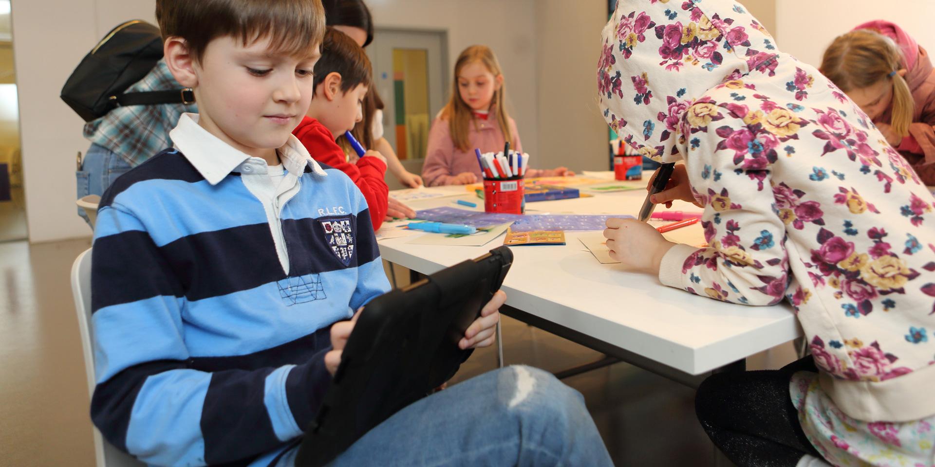 Children on iPads