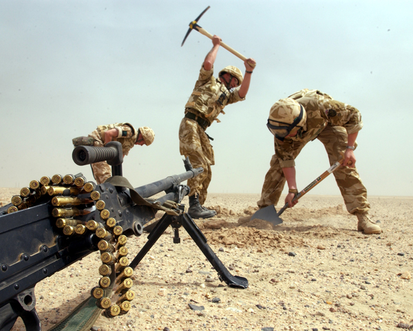 Soldiers dig in during the journey north into Iraq, March 2003